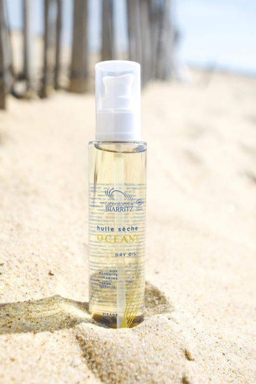 l'huile sèche Bio dans le sable
